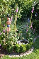 Bildno.: 11346644<br/><b>Feature: 11346627 - The Sculpture Garden</b><br/>Romantic garden in the Saurland, Germany<br />living4media / Pietrek, Sibylle