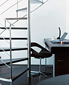 Stainless steel spiral staircase and designer home office