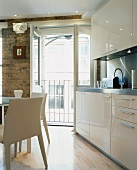 Detail of kitchen with dining area in modernised living space