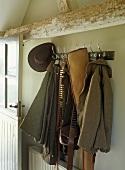 Coat rack in rustic hunting lodge