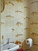 Wallpaper with fish motif in corner of bathroom