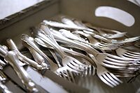 Silver cutlery on tray (close-up)
