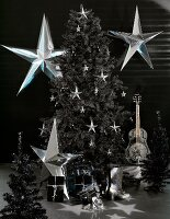 A black and white photo of a Christmas tree and stars