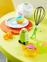 A child's baking utensils (cutters and a whisk)
