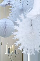Christmas decorations: Paper stars and Chinese lanterns (close up)