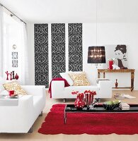 A living room in white with touches of red and black