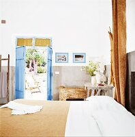 A Mediterranean bedroom with a door leading to a garden