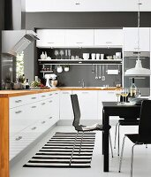 White kitchen-dining room with black accents