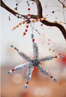 Close-up of decorative Christmas stars on branch