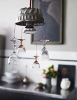 Lamp hand-crafted from cake mould decorated with suspended crystal glasses