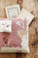 Scented sachets on floral scatter cushion