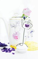 Old china coffee pot used as vase; cupcake and violet bonbons