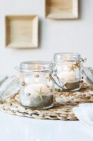 Preserving jars with maritime decoration used as candle lanterns