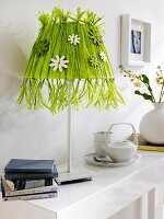 Lamp with lampshade hand-crafted from green raffia & wooden flowers