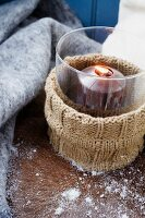 A tealight with a knitted cover