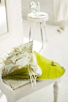Open, green, silk hosiery bag with separate compartments