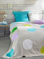 Bed with polka-dot, linen bedspread