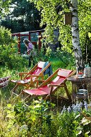 Deckchairs in overgrown garden