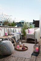 Comfortably furnished roof terrace with candle lantern