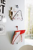 Metal coathangers wrapped in ribbons and upcycled into magazine racks