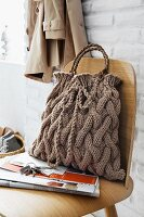 A knitted handbag with a braided pattern