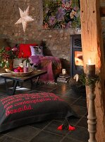 A cosy corner in a fireplace room decorated for Christmas