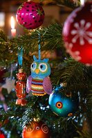 A Christmas tree decorated with a crocheted owl