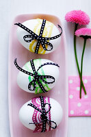 White eggs tied with ribbons