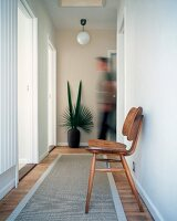 Hallway with 50s chair and runner