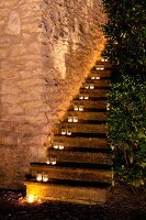 Tealight holders on exterior staircase treads of Provençal stone house