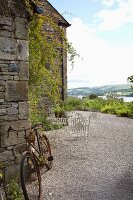 Seating area on gravel terrace with view of landscape
