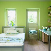 Single bed, French door and writing desk in green bedroom