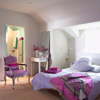 Attic bedroom in shades of lilac and pink