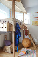 A wooden bunk bed in the corner of a child's bedroom
