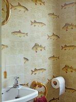 Wallpaper with fish motif in corner of bathroom