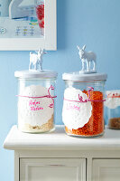 Storage jars with doilies used as labels