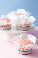 Muffins in doilies on a cake stand