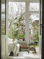 View into conservatory of country house through open door