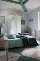 Rustic bedroom with white wardrobe and blue and white-painted wooden floor