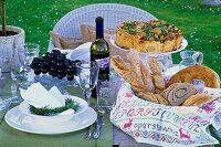 Set table for a springtime party in the garden