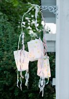 Mobile made of paper-bag lanterns as garden decoration