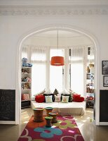 Colourful rug leads through open doorway into child's bedroom
