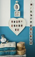 Arrangement of baby photos on wall in child's bedroom with blue and white walls