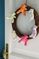 Door wreath decorated with teddy bears