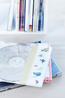 Tape with butterfly motif on transparent CD sleeve