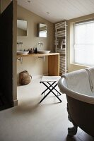 Freestanding vintage bath tub in a modern bathroom