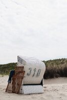 Roofed wicker beach chair at the dune beach on Spiekeroog (Germany)