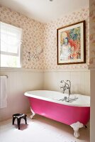 Pink free-standing bath in bathroom with dado wood panelling and Kathryn Ireland Quilt wallpaper