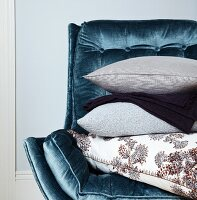 Pillows Stacked on a Velvet Chair