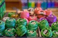 Balls of various yarns in craft shop